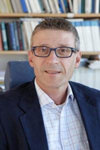Johan Woxenius, professor i sjöfartens transportekonomi och logistik vid Göteborgs universitet är rädd att Sveriges rykte som handelspartner påverkas av hamnkonflikten. Foto: Minna Undin.